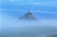 France, Normandy, Mont Saint Michel, seen through early morning fog