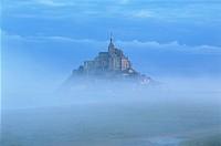 France, Normandy, Mont Saint Michel, seen through early morning fog