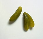 One whole and a halved pickled gherkin