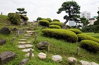 Japan, Tokyo, Chuo-ku, Hamarikyu Gardens, stepping stones on the side of a hill