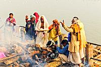 Hindu cremation ceremony at Manikarnika Ghat on banks of holy Ganges river, Varanasi, Benares, Uttar Pradesh, India, Asia.