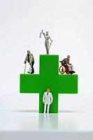Figurine with green medical symbol