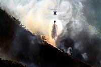 August 2013 Lugo Fire in Navia, in Ancares, Natura protected area, Biosphere and reserba. It affects more than 500 hectares of forest. Aerial and terr...
