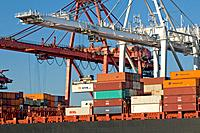 Container cranes transferrng cargo from container ship at Port of Seattle, Seattle Washington USA.
