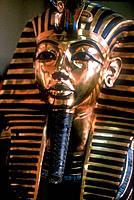 Gold mask of Tutankhamun on his mummy-case. Tutankhamun reigned between 1336 BC and 1327 BC.