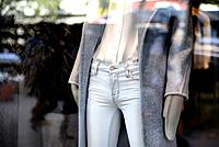 Store Window Mannequin wearing tight, light blue jeans, white shirt blouse, warm fleecy coat and warm mittens, New York City