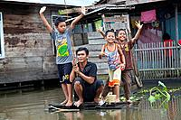 Joyful Children at a Canal in Banjarmasin, Indonesia.