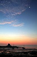 Lindisfarne Castle and Moon - at sunrise over harbour