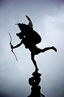 Silhouette of statue of Eros God of love, Piccadilly Circus, London, England, Europe.