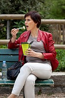 WOMAN EATING A MEAL
