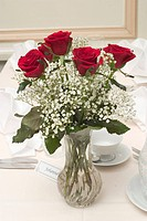 Red roses and white flowers in vase