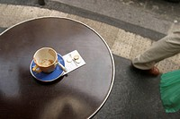 Empty cup with tip in restaurant