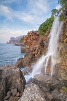 Northwest coast of Majorca. Sa Costera intermitent fresh water spring waterfall. Balearic islands, Spain.