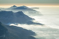 Southern Tramuntana mountains and northern coast under the mist at sunset. Aerial view. Majorca, Balearic islands, Spain