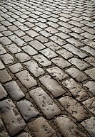 A well worn pavement of granite cobblestones in London.