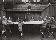 Scouts practising the rescue of people from burning buildings during the First World War.