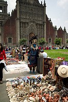 Mexico, Mexico City, vendors and performers outside the Cathedral Metropolitana,Zocalo area Souvenir vendors, and indian dancer in front of the Cathed...