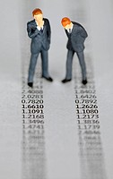 Toy Figures of Businessmen on Financial Pages