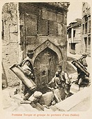 A Turkish fountain at Constantinople. Three Turkish water carriers filling up their backpack water bags at the source.