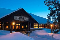 Night shot exterior of Snow Lodge at Yellowstone National Park at Old Faithful Geyser Basin, Wyoming, USA.