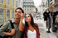 Portugal, Lisboa, Baixa, young couple regarding architecture