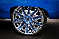 Creative image of shining car tire with chrome rim