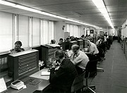 General view of the Metropolitan Police Information Room at New Scotland Yard, London, with officers busy taking calls. In the foreground are the Insp...