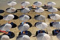 Aerial view of sun umbrellas, Beach of Georgioupoli on the north part of Crete, Greece.