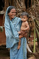 A mother and her son; Ratapata Village, Badamba, India