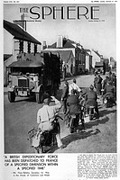 A British column of Army lorries is cheerily greeted by French military motor cyclists as it moves through a French village in the early weeks of Worl...