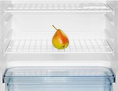 Single pear in fridge close_up