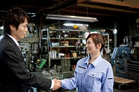 Young Woman Shaking Boss?S Hand