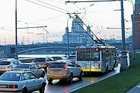 Traffic jam along the road on the embankment aside of the Kremlin walls with the Cathedral of Christ the Savior´s in the background, Moscow, Russia, E...
