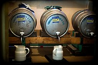 Tree barrels of beer with jugs, Timothy Taylor´s brand in a pub in Yorkshire Dales, England, UK, Europe.