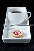 Cup of coffee with small shortbread biscuit