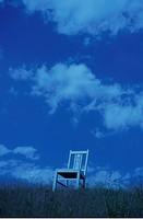 Chair on hill against cloudy sky. Mt Yatsugatake, Yamanashi Prefecture, Japan