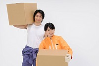 Portrait of Young Female and Male Workers, Carrying Carton Box