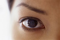 Close up of a young woman's face. Eye and eyebrow.