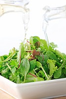 Pouring Salad Dressing Glass Bottle Leaf Lettuce
