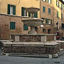 Pispini Fountain (Fontana dei Pispini), 13th Century. Italia, Tuscany, Siena. Totale. Whole artwork view. The fountain (marble and red bricks) gets it...