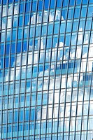Clouds reflected in a modern office building in Southwark, close to the Shard, in the heart of London, England.