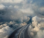 Clouds surrounding winding highway