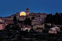 Full moon rising behind Monte Castello di Vibio, Umbria, Italy