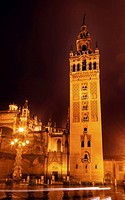 Giralda Spire, Bell Tower, Seville Cathedral, Rainy Night, Car Trails, Seville, Andalusia Spain. Built in the 1500s. Largest Gothic Cathedral in the W...
