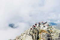 Hikers on summit of Mount Rysy, 2499m, the highest point in Poland, Zakopane, Carpathian Mountains, Poland, Europe