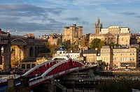 Swing Bridge crossing the River Tyne, 12th century Norman Castle Keep and the Lantern of the Cathedral Church of St. Nicholas, Newcastle upon Tyne, Ty...
