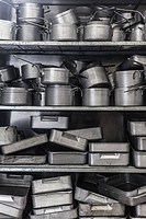 Shelf full of baking tins