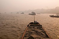 Chinese cargo ships on the Mekong River, from Chiang Saen Thailand, to Jinghong China