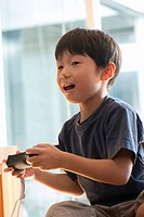 Japanese kid playing a video game