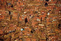 Bolivia, La Paz, overview of the capital city of Bolivia, and the crowded and packed city with its red orange brick walls and roofs.